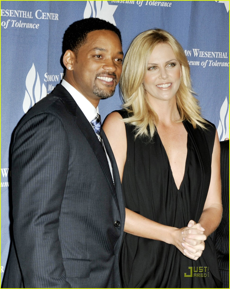http://cdn04.cdn.justjared.com/wp-content/uploads/2009/05/theron-smith/charlize-theron-will-smith-17.jpg