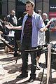 ryan seacrest standing on top of box 09