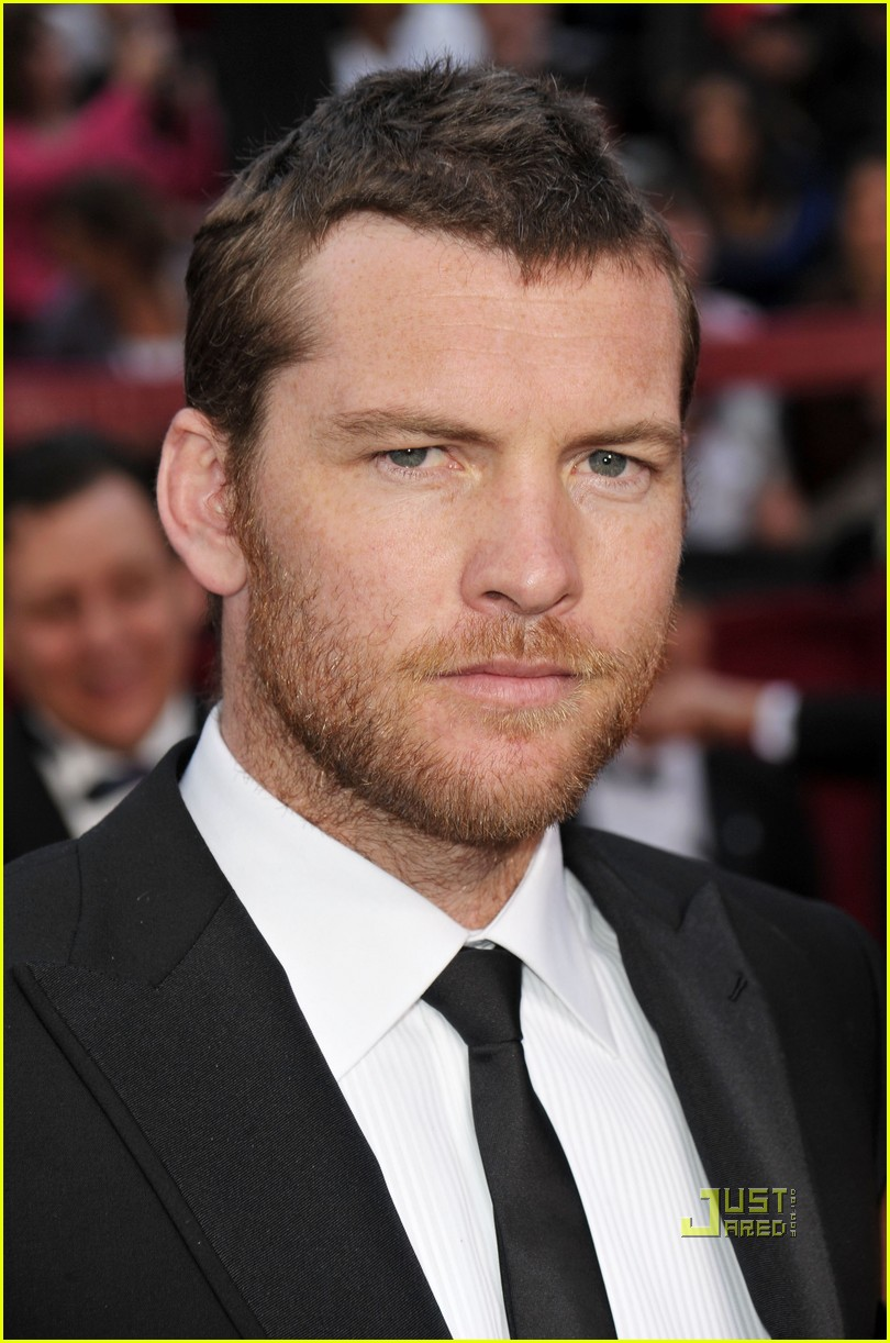sam worthington natalie mark 2010 oscars red carpet inside 08