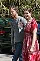 anne hathaway adam schulman studio city red dress 01