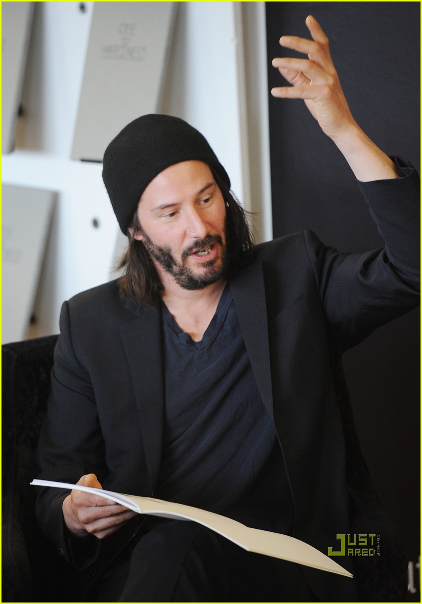 keanu reeves ode to happiness book signing keanu reeves bike trouble