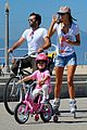 alessandra ambrosio family biking 01