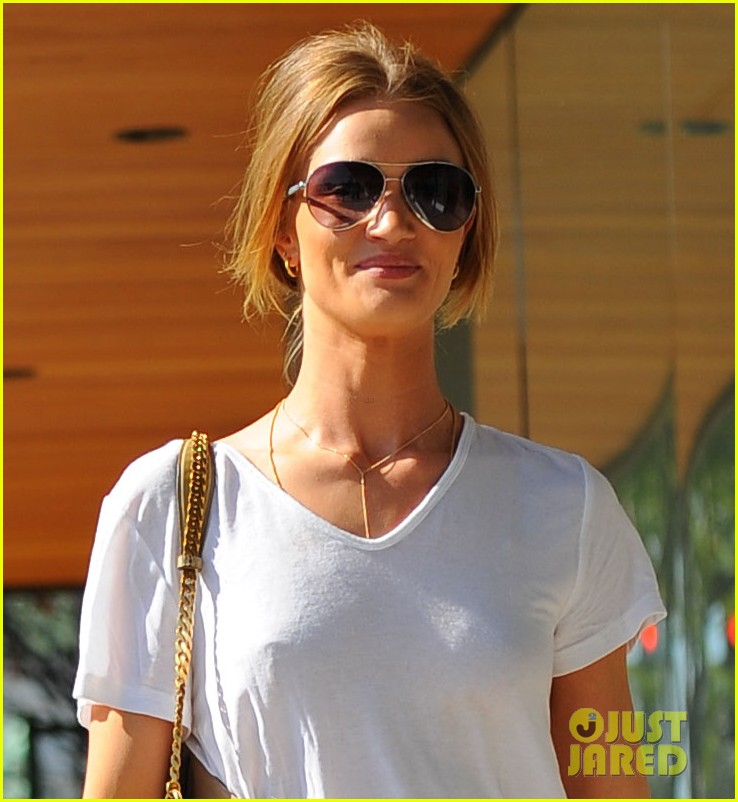 rosie huntington whiteley cracks smile 02