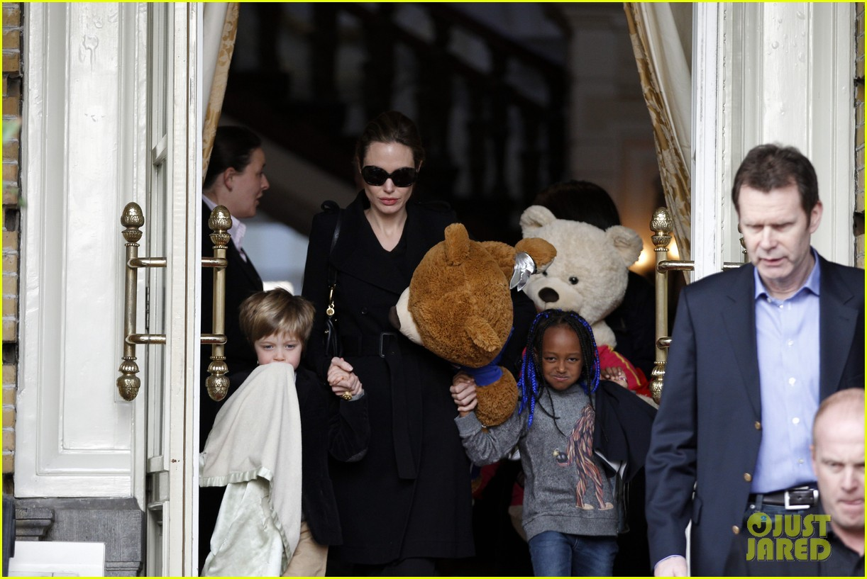 angelina jolie girls leaving hotel 01