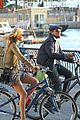 leonardo dicaprio erin heatherton biking twosome 03