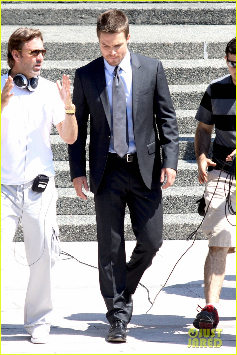 stephen amell suits up on arrow set 08