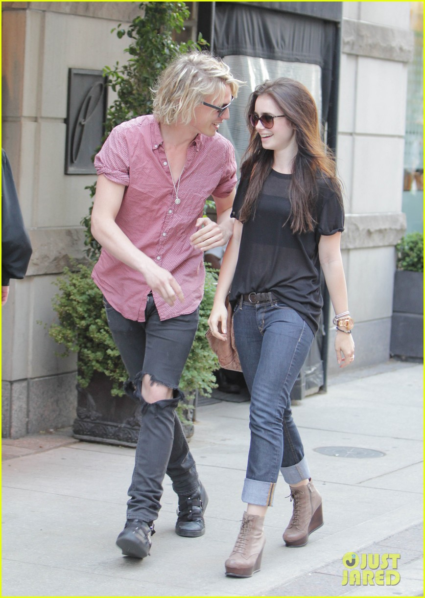 lily collins jamie campbell bower hold hands toronto 01