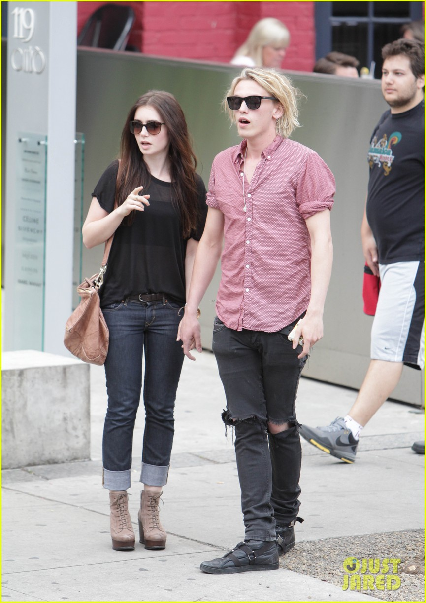 lily collins jamie campbell bower hold hands toronto 05
