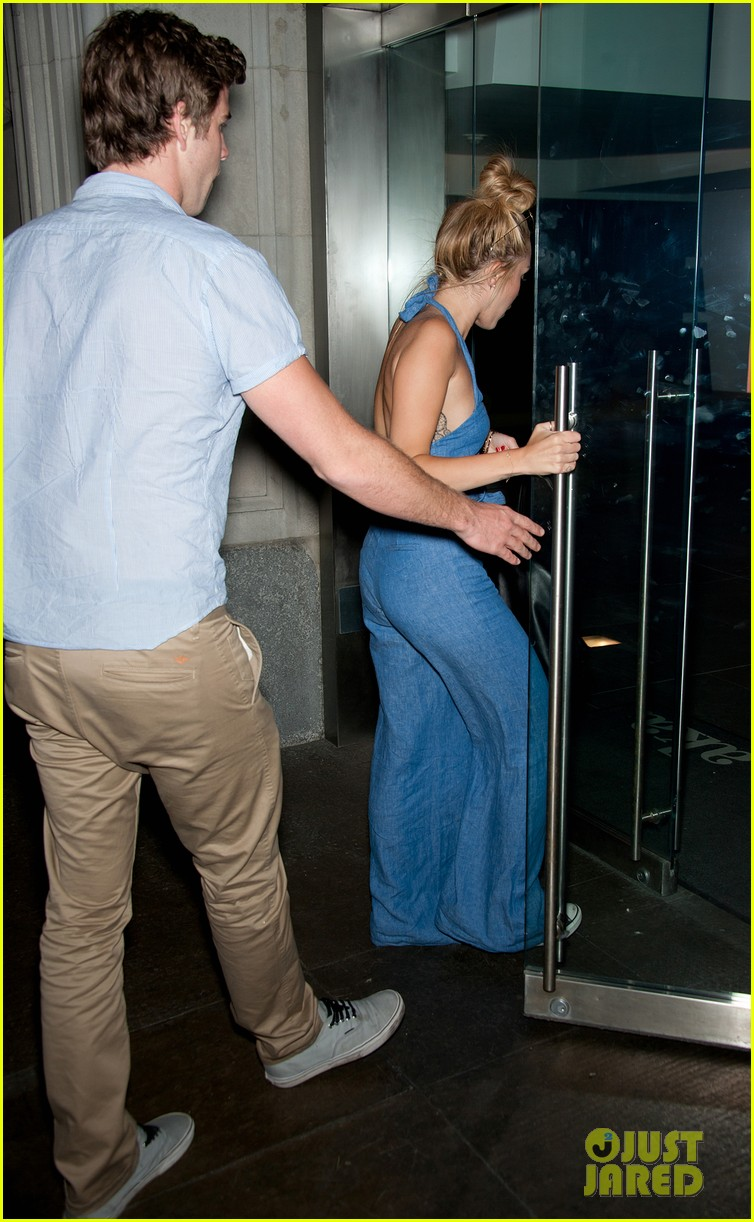 miley cyrus denim jumpsuit with liam hemsworth 032689584