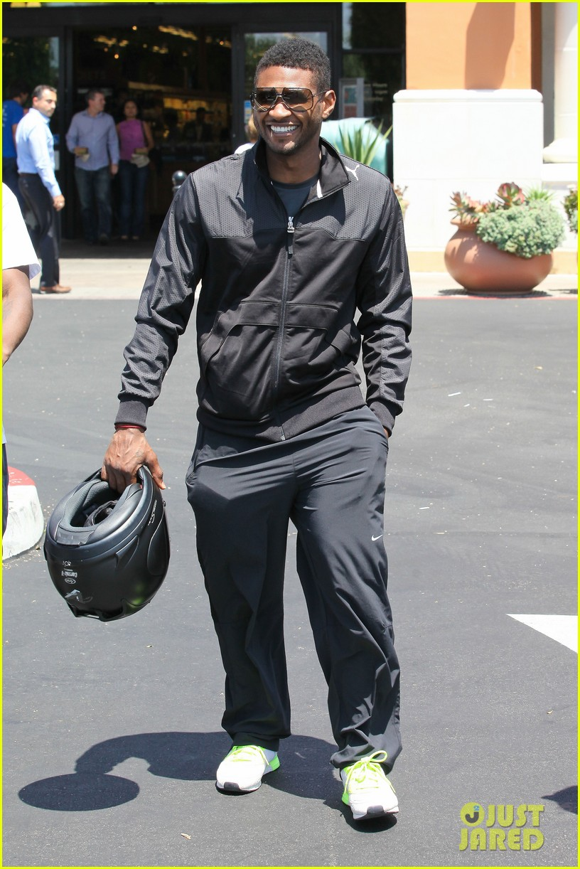 usher steps out after stepsons tragic death 01