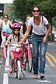 katie holmes teaches suri cruise to ride a bike 01