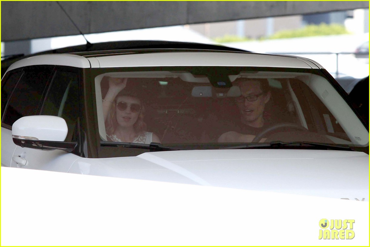 january jones holding hands mystery man 022705624