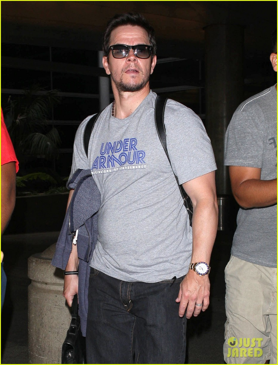 mark wahlberg arrives on flight 02
