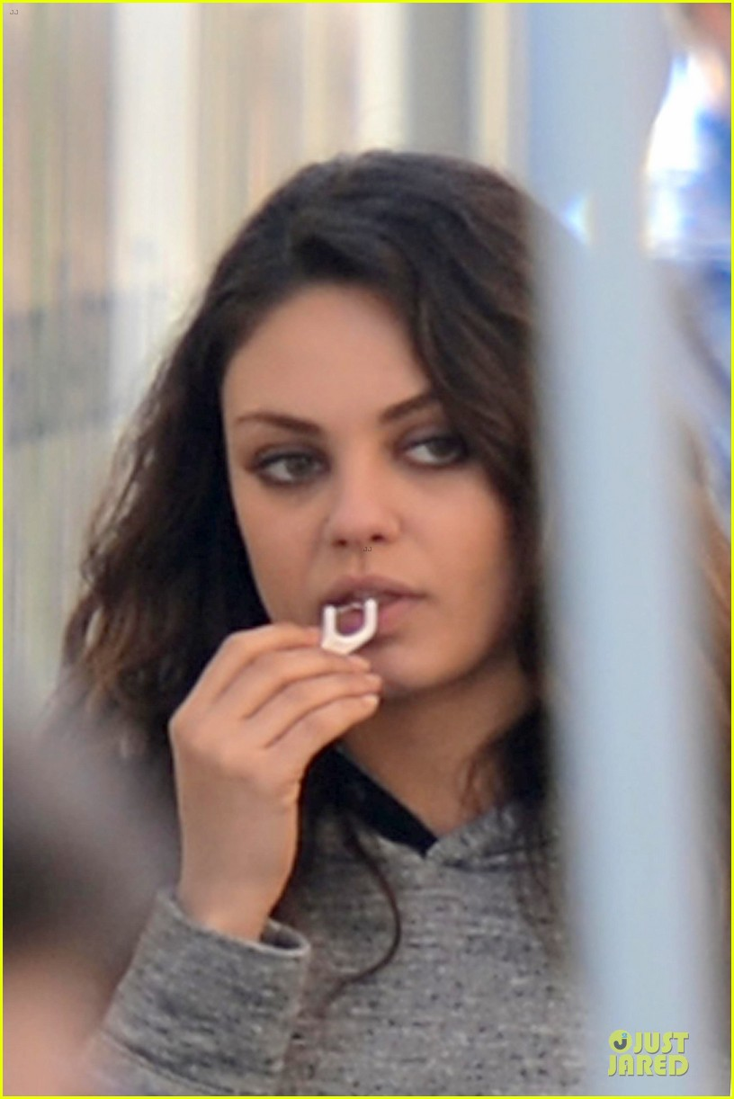 mila kunis teeth cleaning on third person set 32