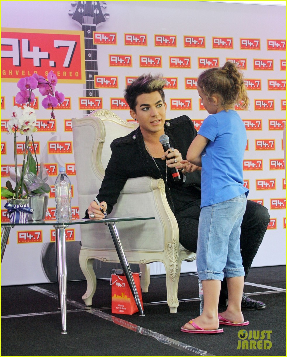 adam lambert hugs lucky young fan in south africa 01