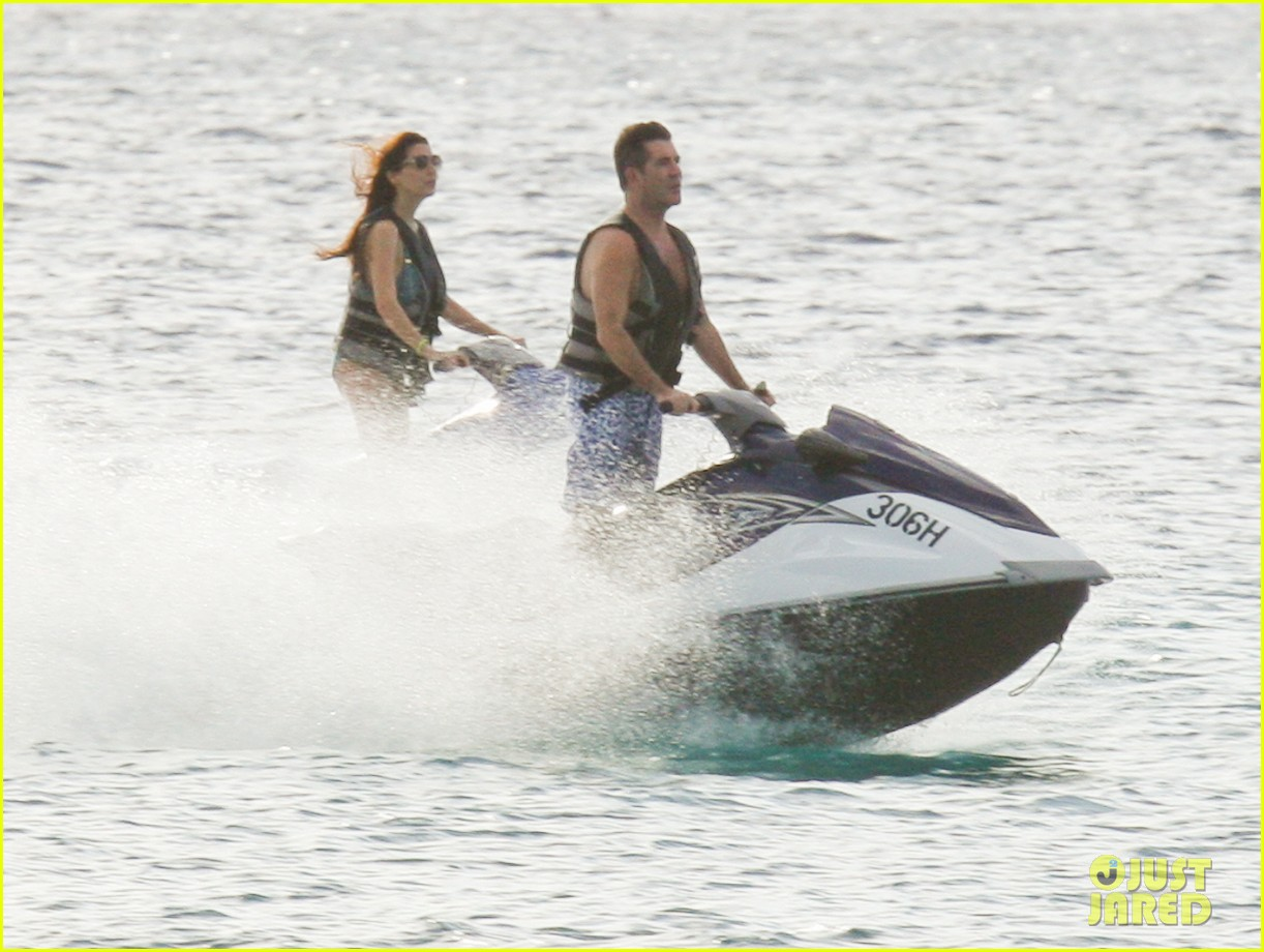 simon cowell jet skiing with former fiancee mezhgan hussainy 07