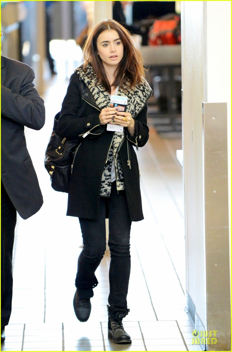 lily collins passport departure at lax airport 03