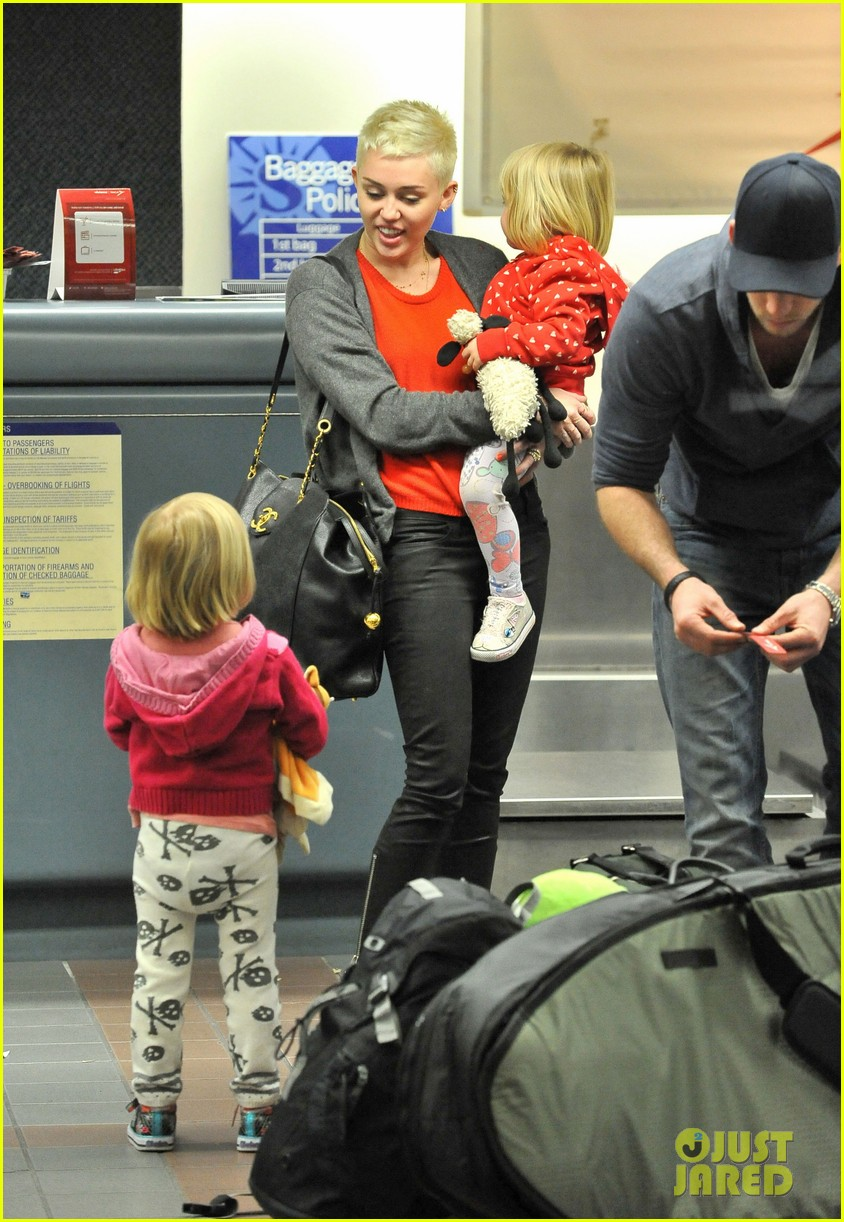 miley cyrus liam hemsworth take flight with the family 01