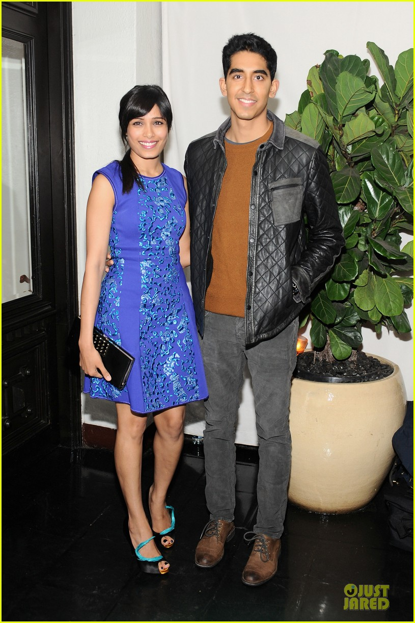 freida pinto dev patel w magazine pre golden globes party 03