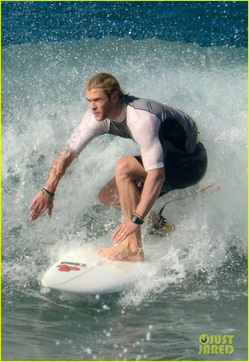 chris liam hemsworth shirtless surfing duo 272799404