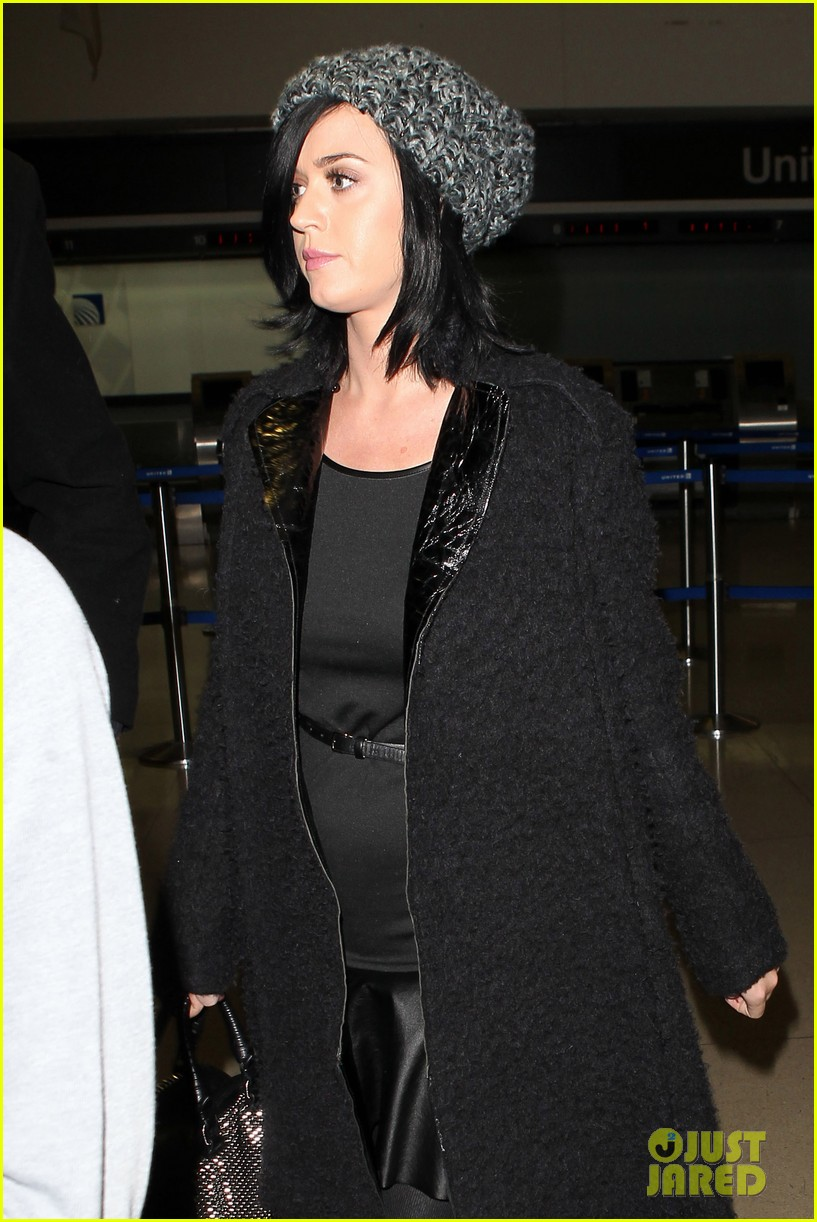 katy perry eva longoria arrive at lax after inauguration 05