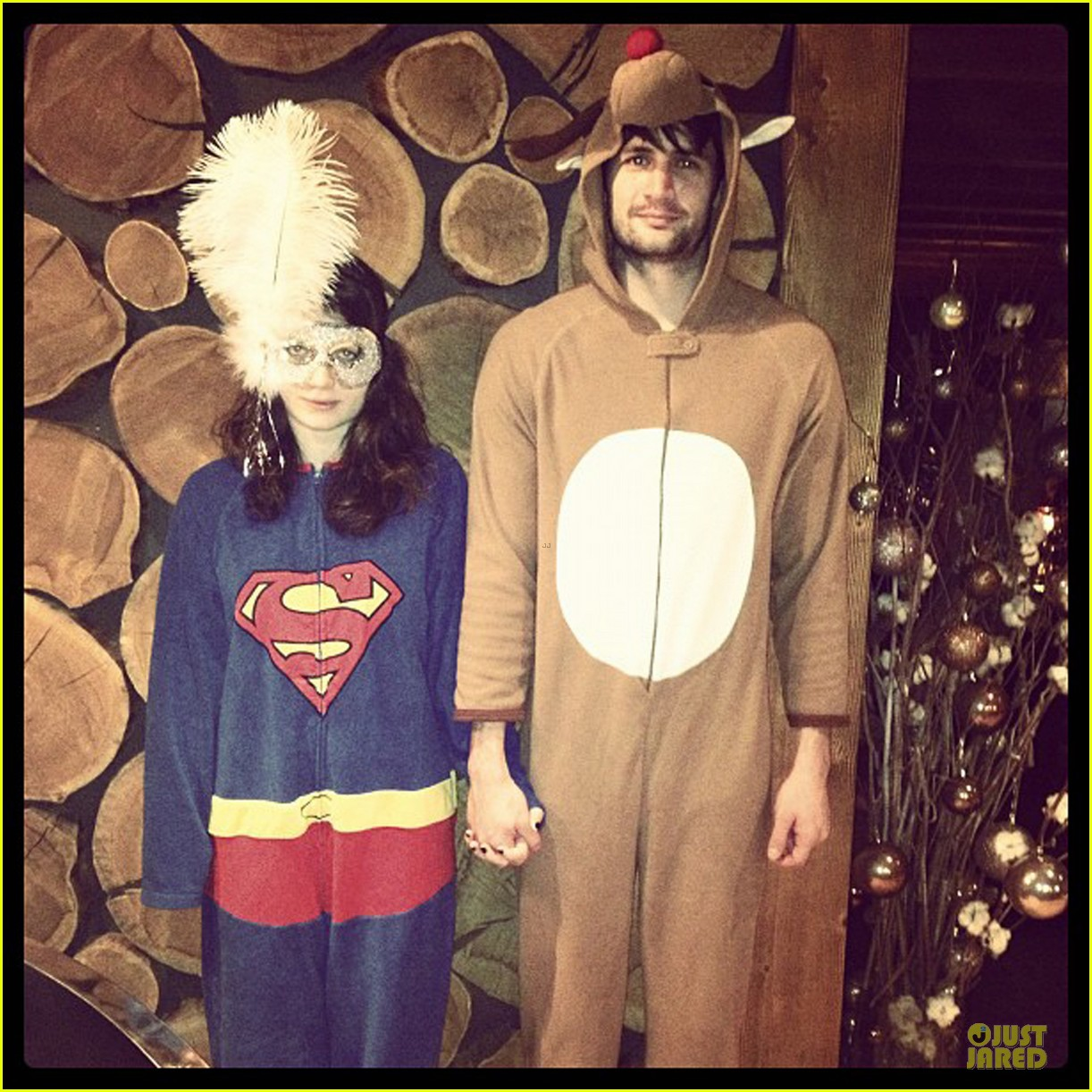 james lafferty & eve hewson costumed & holding hands 06
