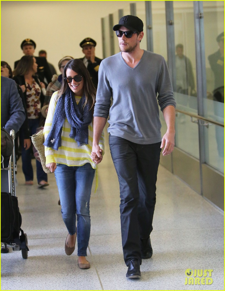 lea michele cory monteith holding hands at lax 09