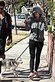 miley cyrus hoodie walk with pet pooch 01