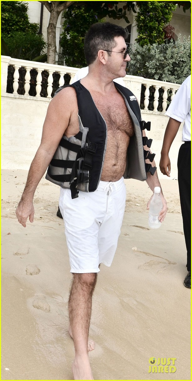 simon cowell shirtless new years eve with mezhgan huissany 06