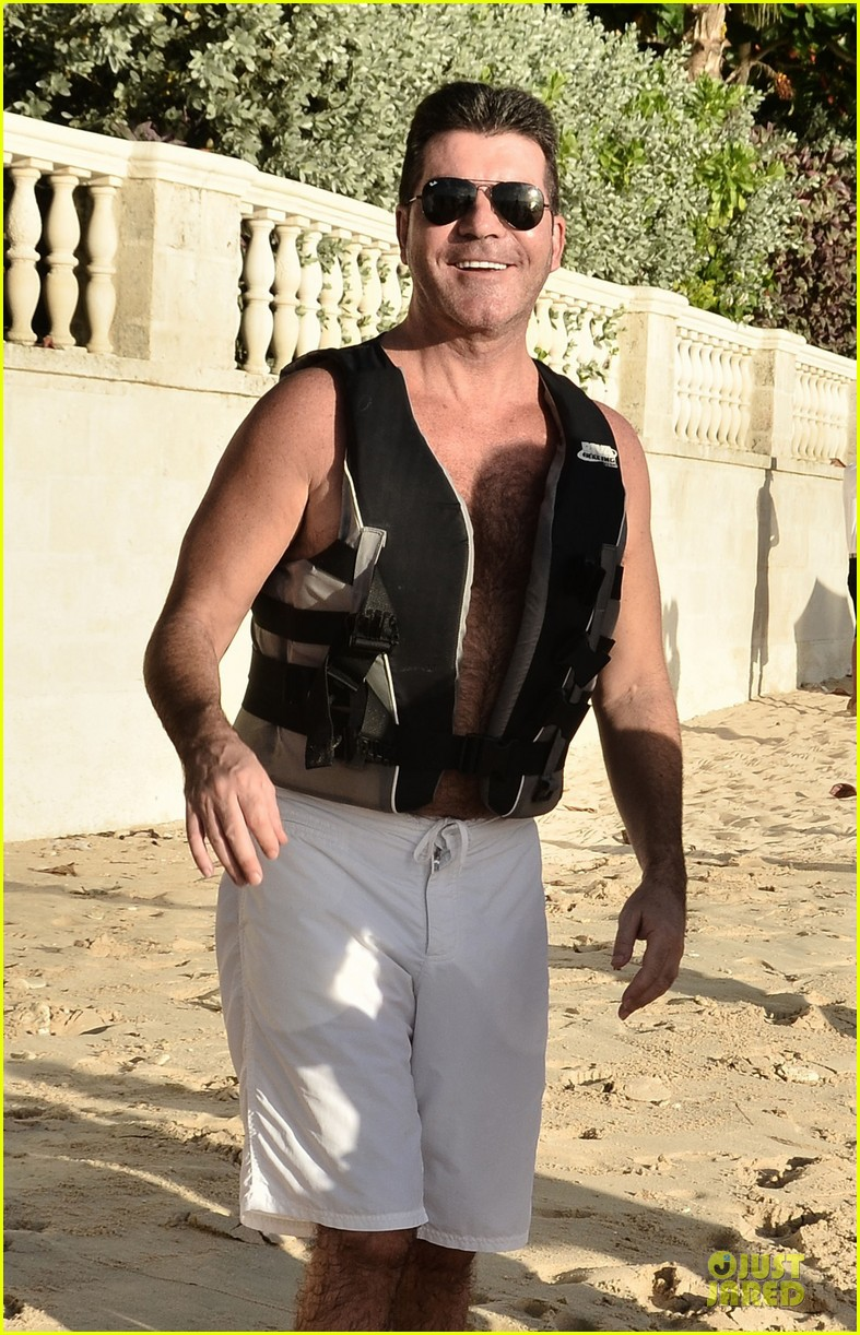 simon cowell shirtless new years eve with mezhgan huissany 17