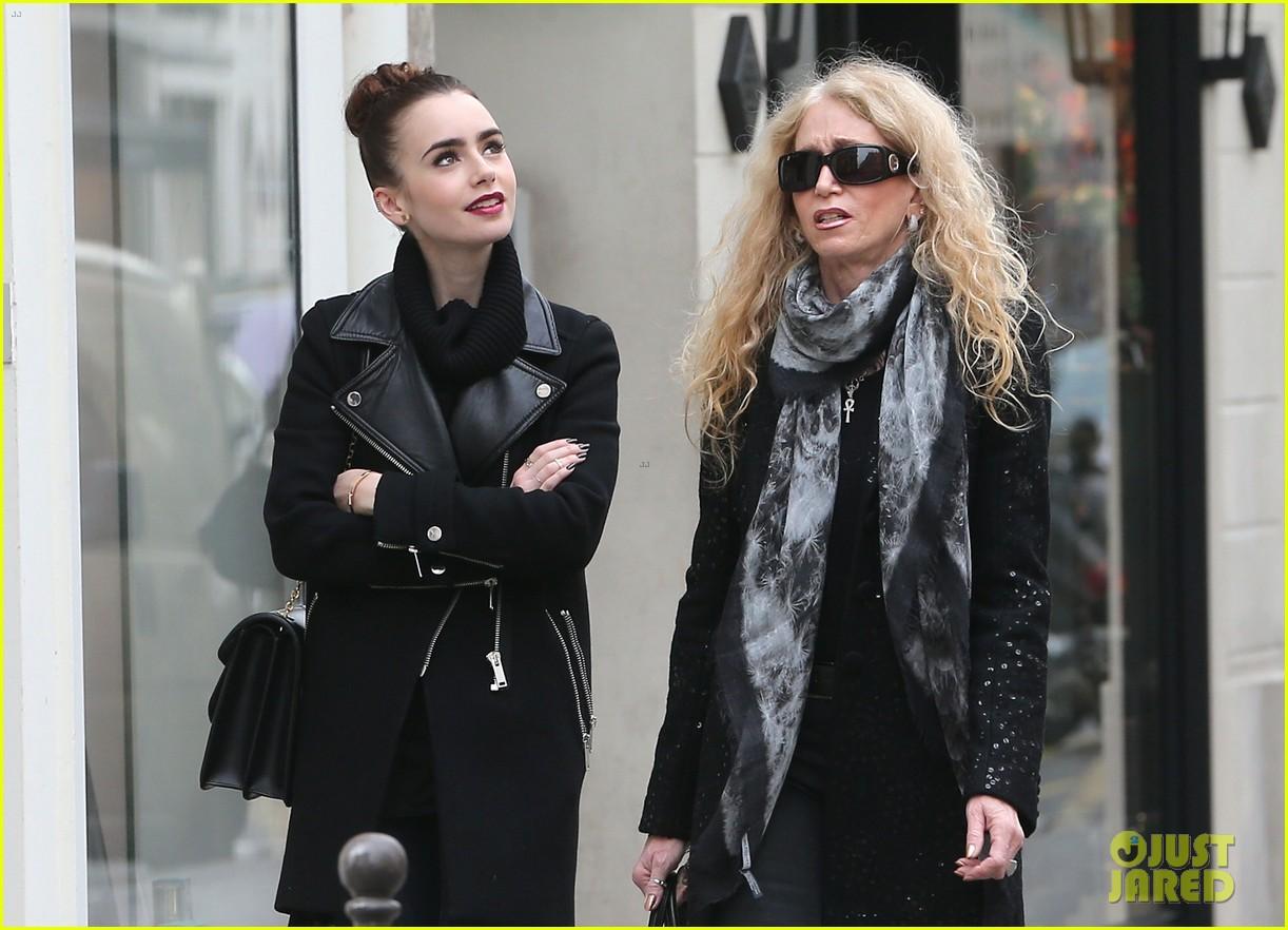 lily collins elizabeth olsen paris fashion week fun 132826396