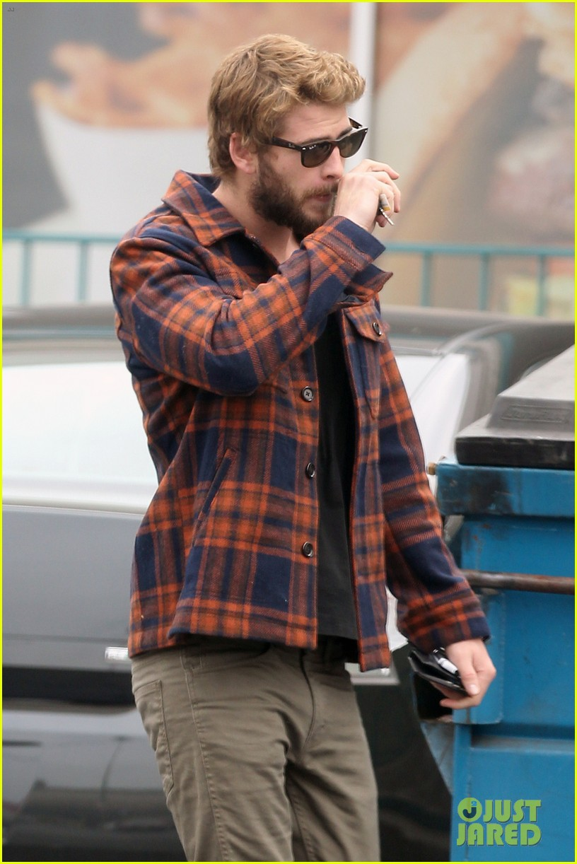 miley cyrus goes to photo shoot liam hemsworth grabs bite to eat 04