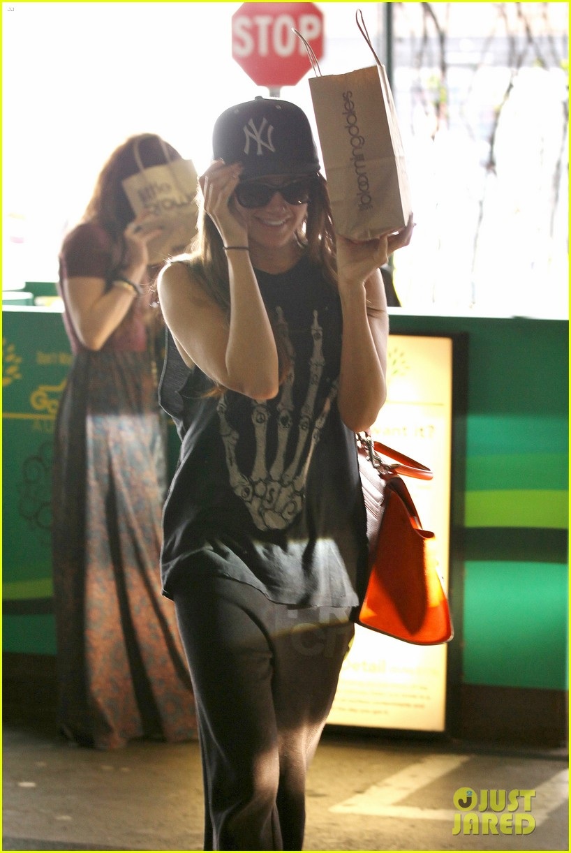 vanessa hudgens ashley tisdale hide behind their bags 202842953