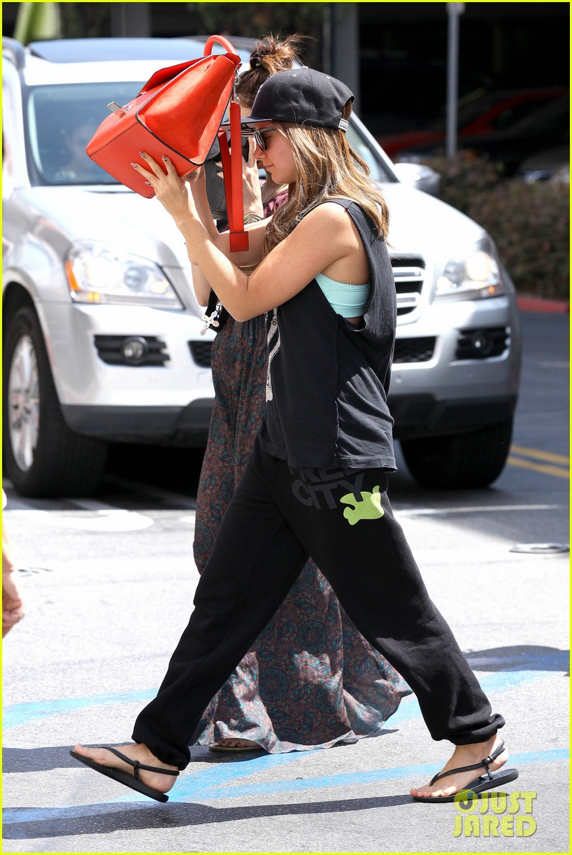 vanessa hudgens ashley tisdale hide behind their bags 222842955