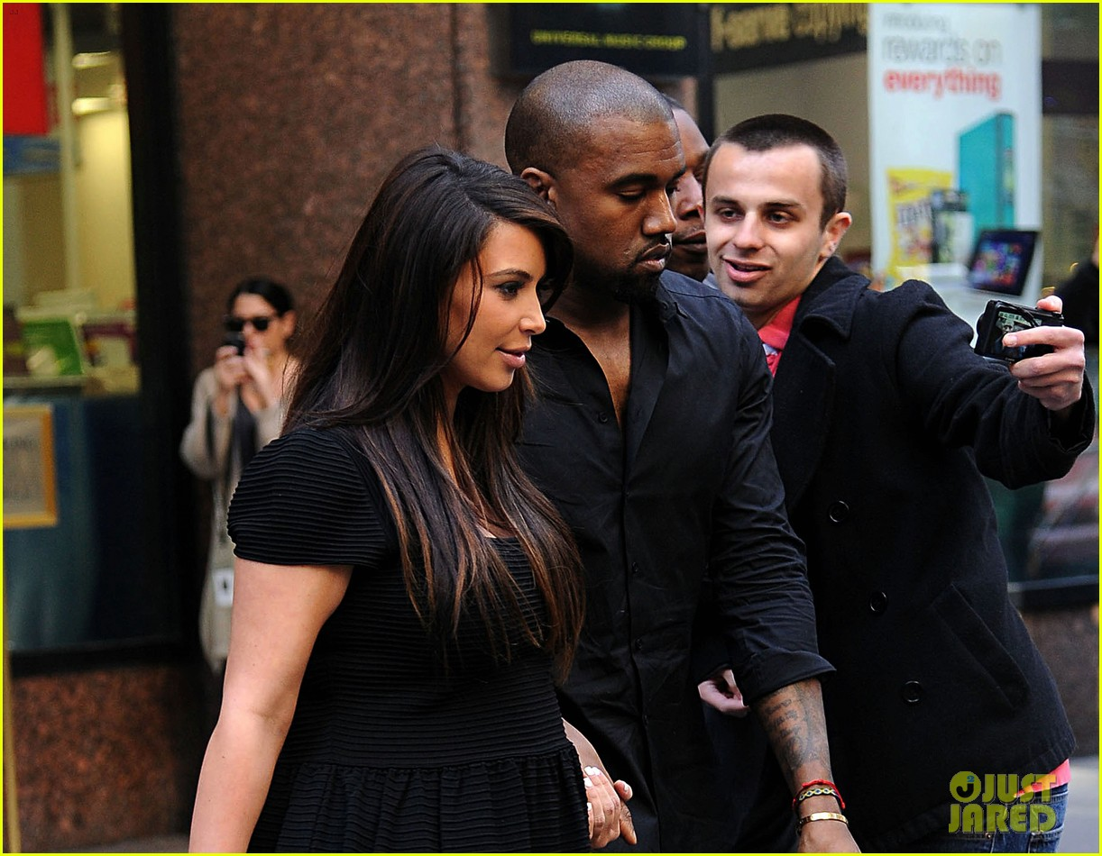 kim kardashian kanye west rushed by fan wanting photo 02