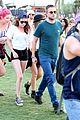 kristen stewart robert pattinson holding hands at coachella day two 12