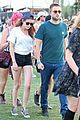 kristen stewart robert pattinson holding hands at coachella day two 17