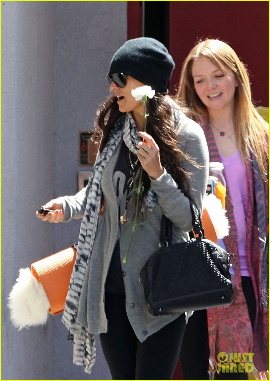 demi lovato carries a white rose out of yoga class 022868989