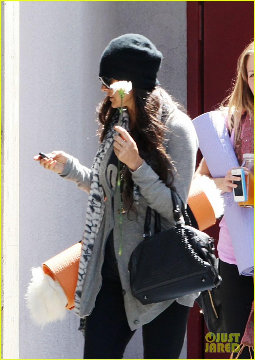 demi lovato carries a white rose out of yoga class 12
