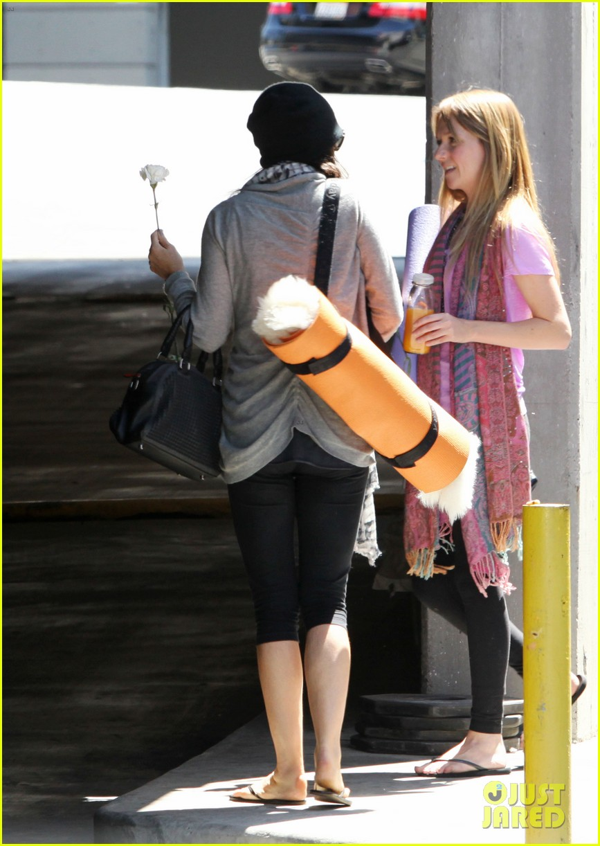 demi lovato carries a white rose out of yoga class 14