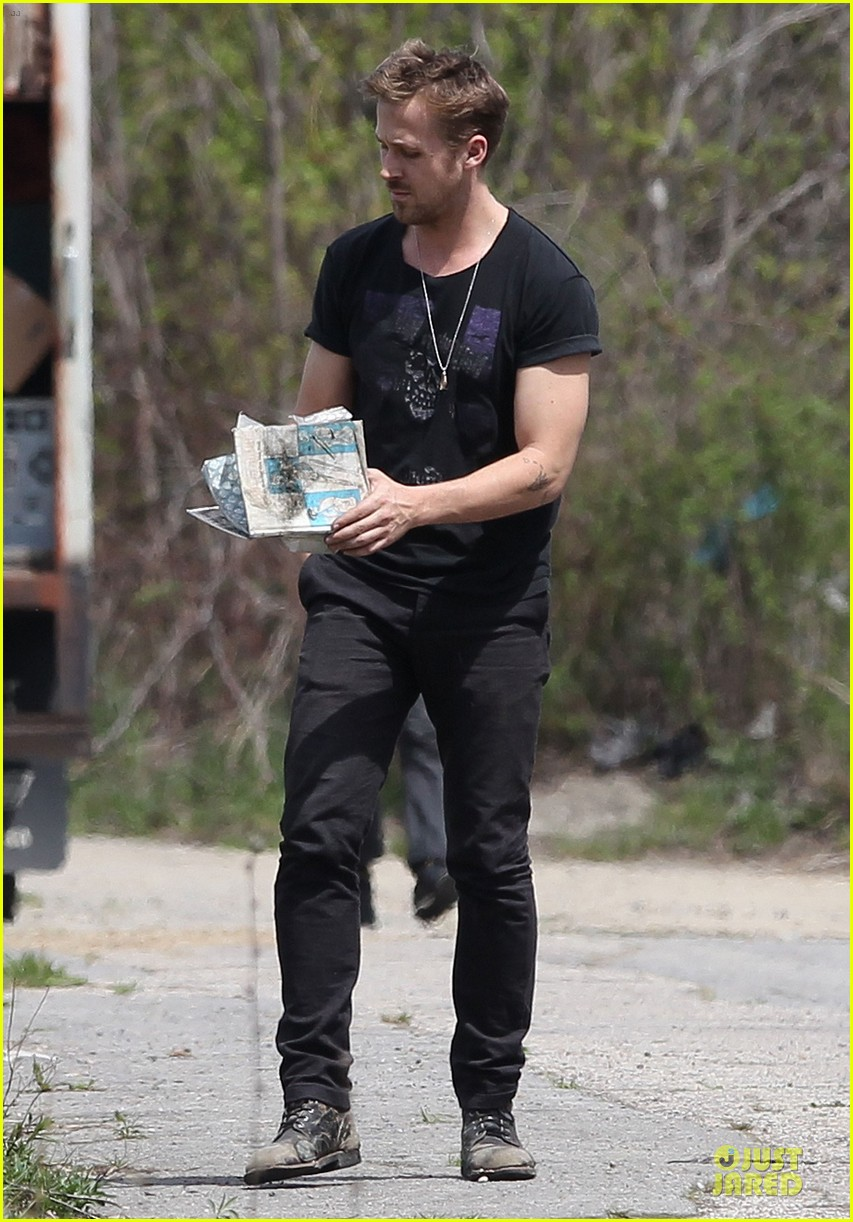 ryan gosling bulging biceps on how to catch a monster set 132863584