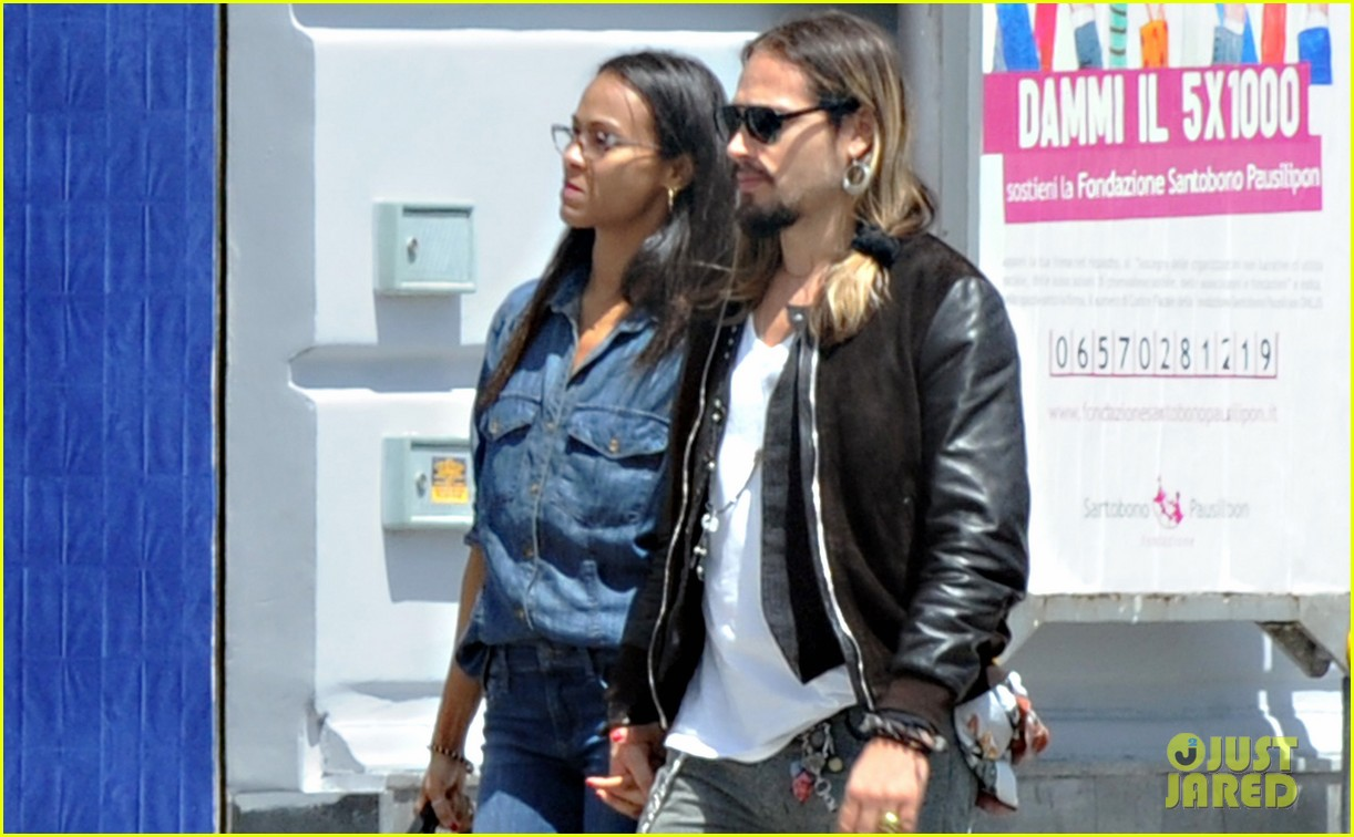 zoe saldana marco perergo kiss hold hands in italy 03