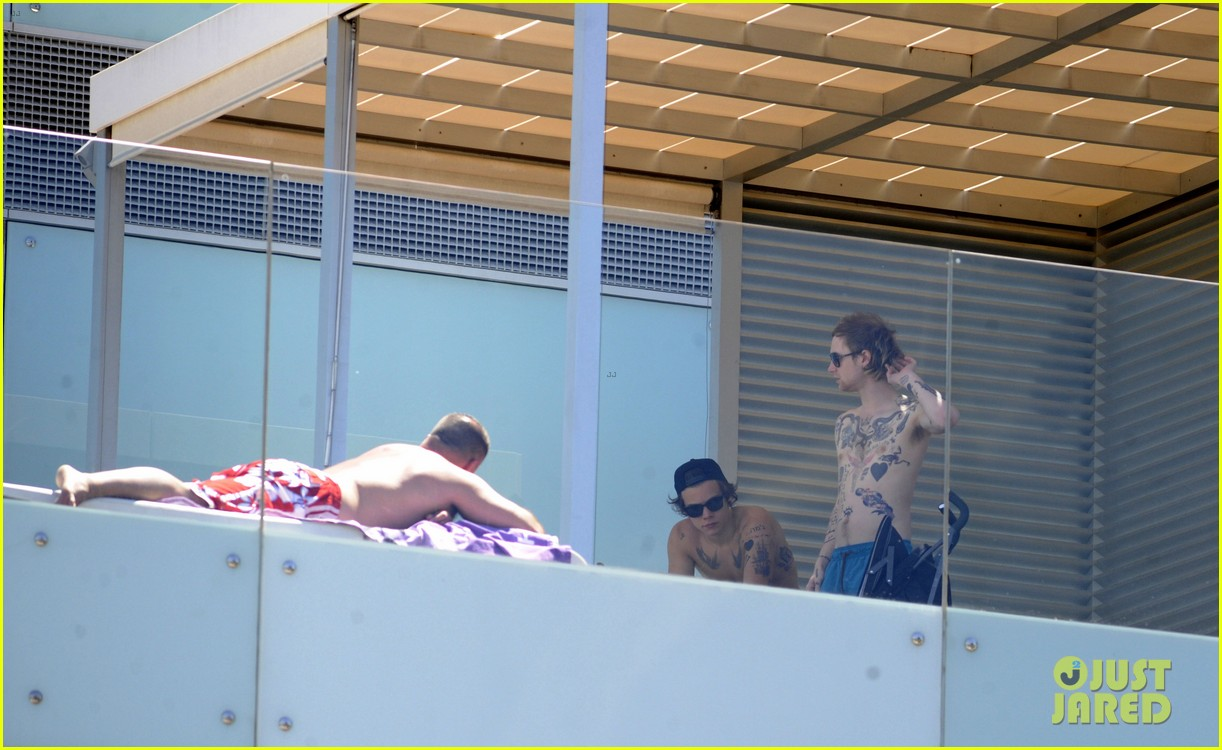 harry styles shirtless poolside in spain 162876317