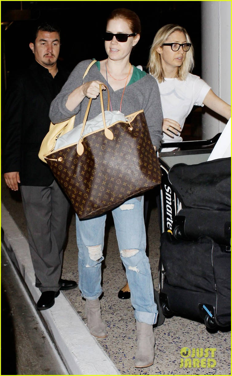 amy adams lands at lax after man of steel breaks records 01