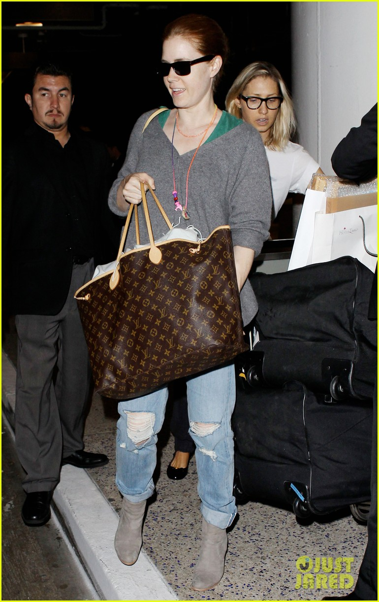amy adams lands at lax after man of steel breaks records 04