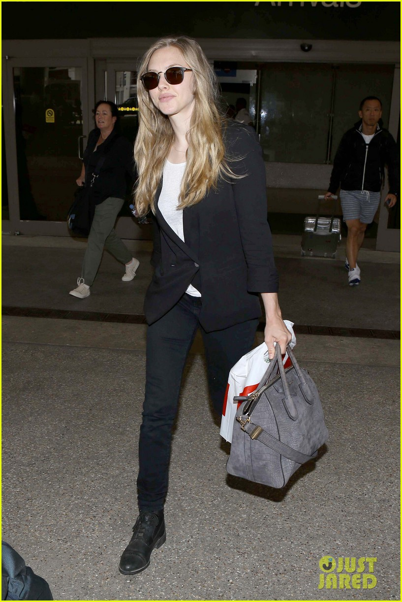 amanda seyfried returns to la after hong kong trip 072887654