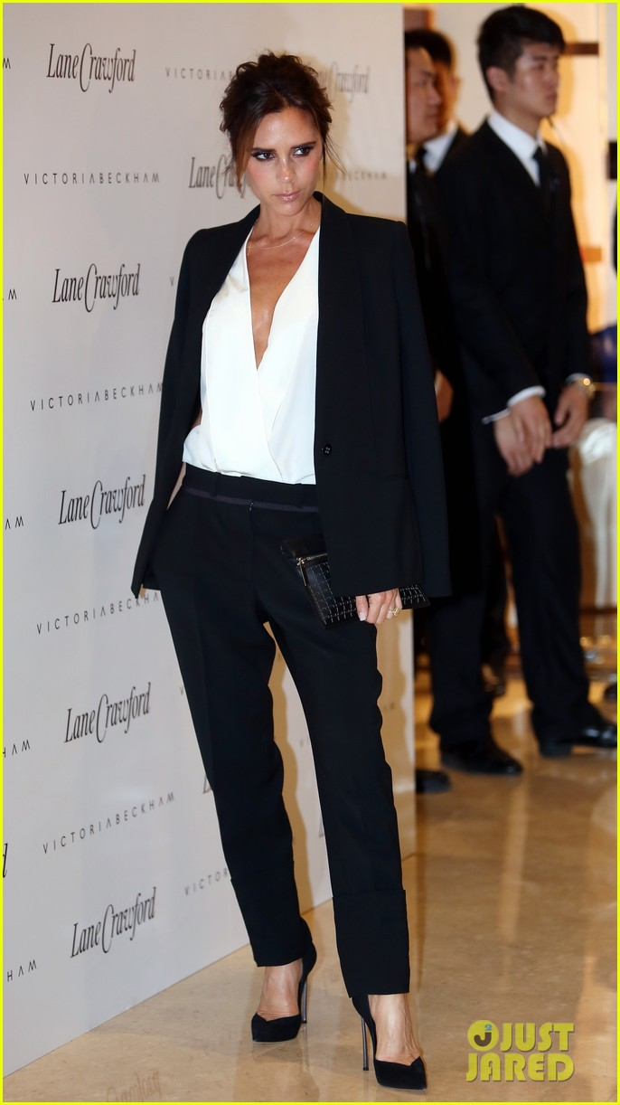 victoria beckham promotes fashion line david beckham greets at hm 122898782