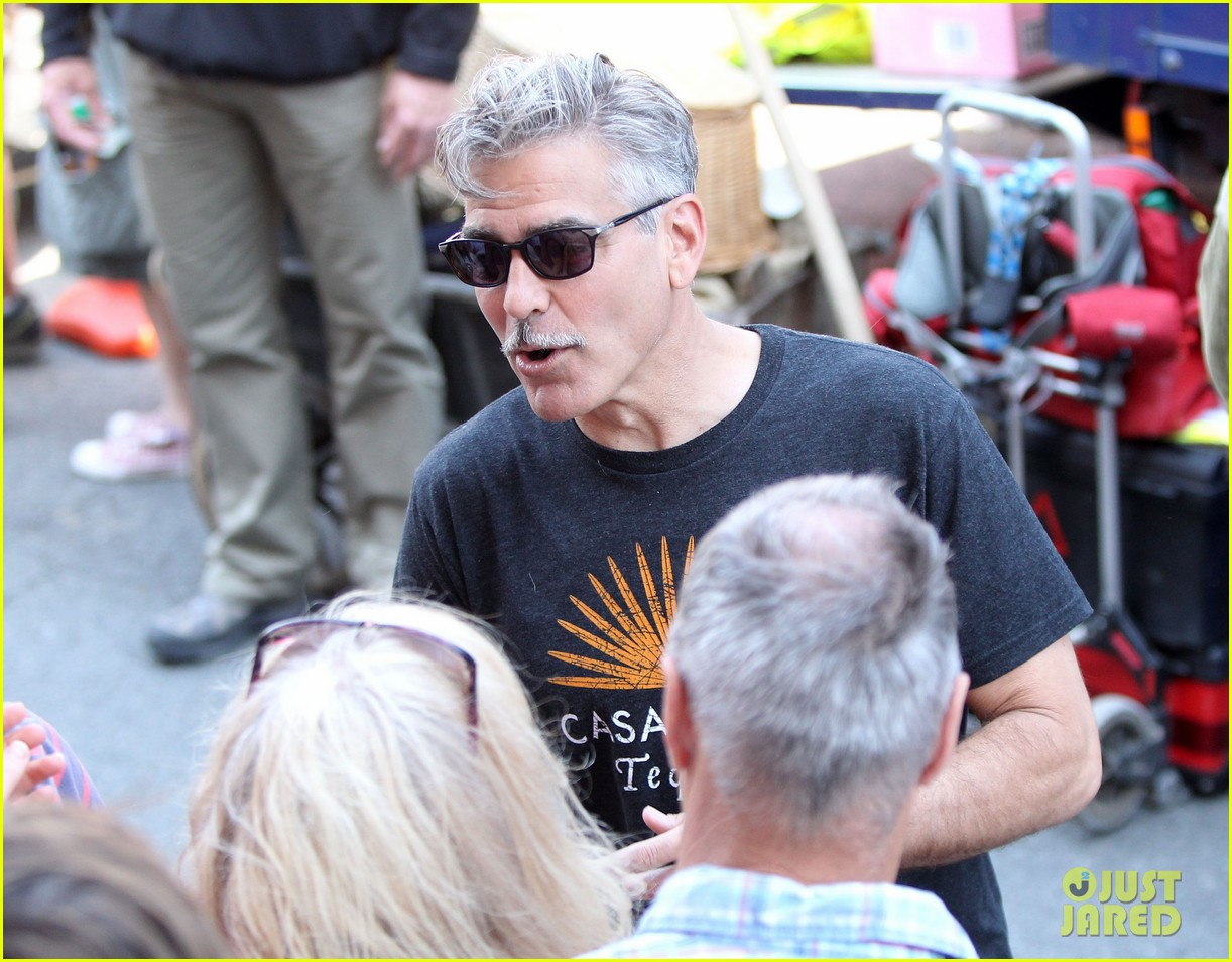 george clooney greets fans on monuments men set 042885859