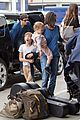 jennifer connelly paul bettany lax arrivial with the kids 01