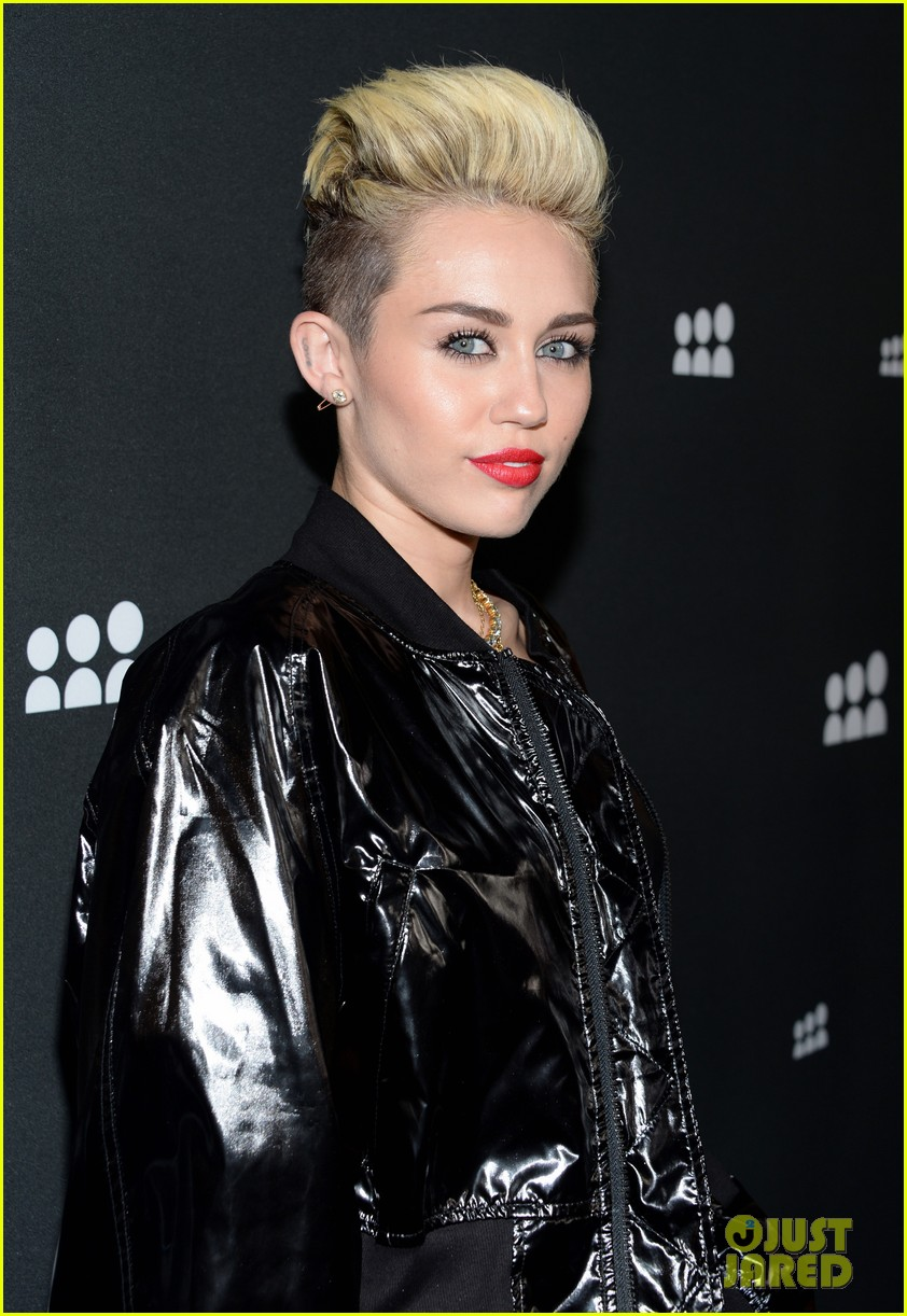 miley cyrus sweatpants jeans combo at myspace event 102890290